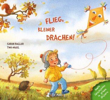 """Covermotiv vom Buch """"Flieg, kleiner Drachen"""". Man sieht einen Jungen einen Drachen steigen lassen."""